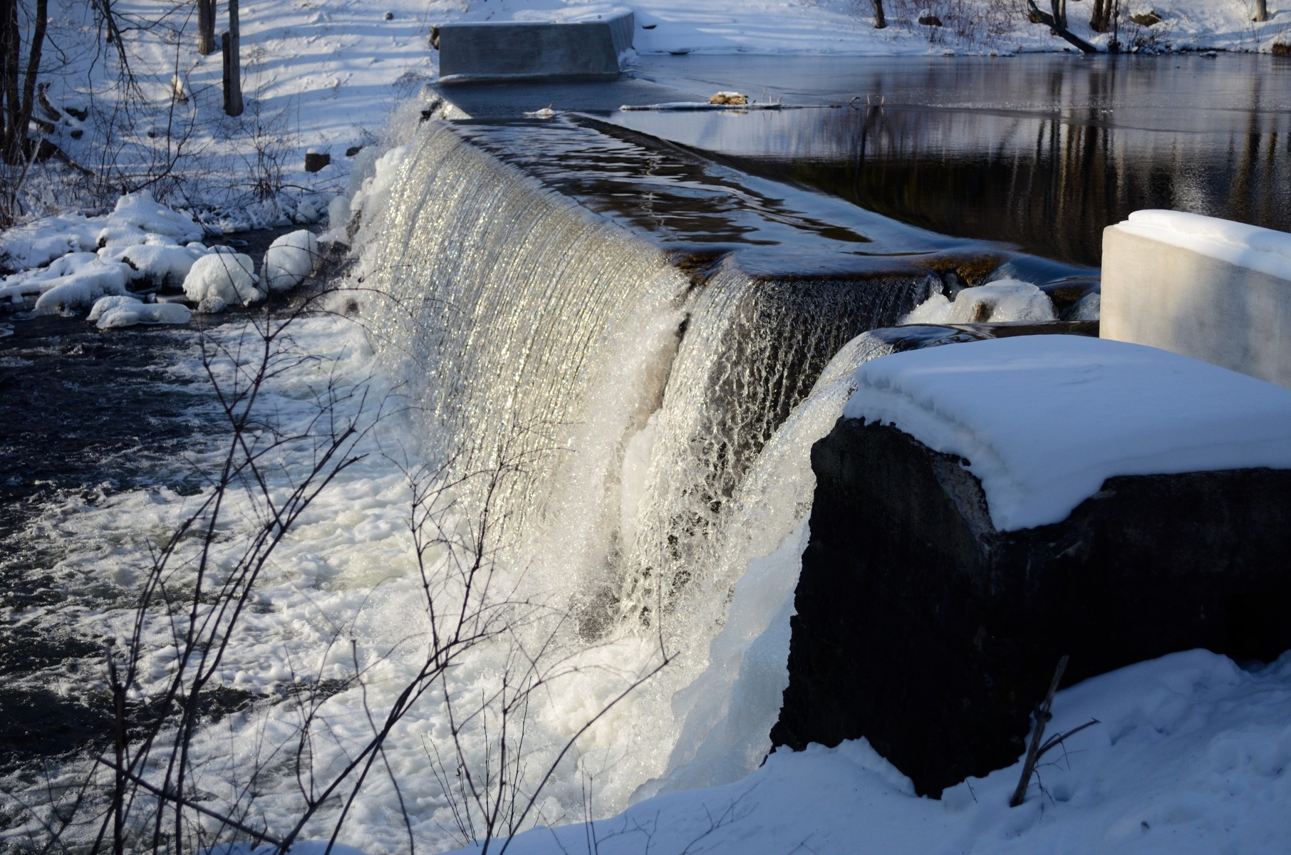 maine dam in winter by ryan fish