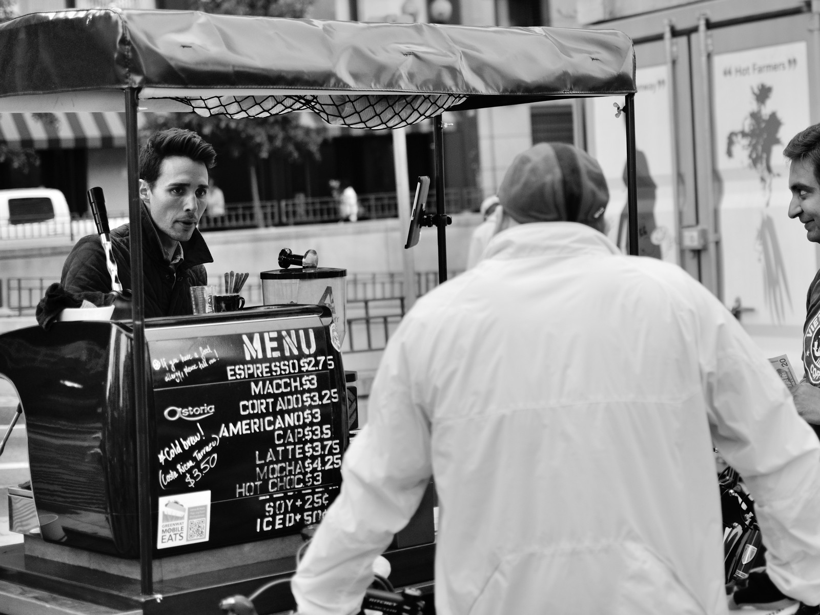 two men order espresso at a stand in boston
