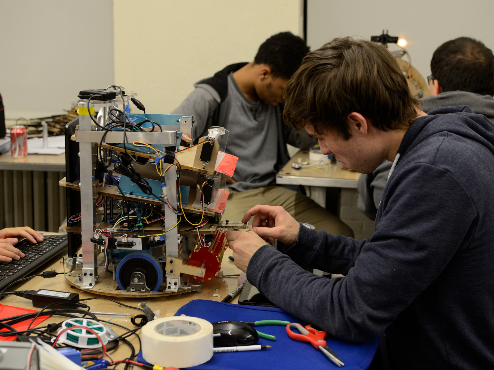 jacob haip adds tape to ball retriever mechanism for maslab robot